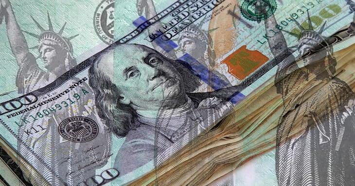 stack of one-hundred US dollar bills