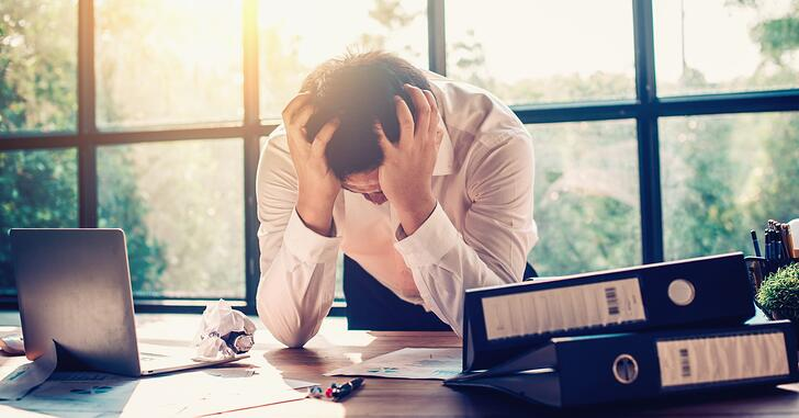 M&A Deal Fatigue: What It Is and How to Prevent It – frustration, businessman, desk, tired, exhaustion – Redpath
