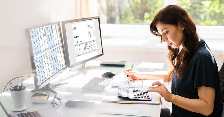 woman at desk going over numbers on a computer comparing strategic accounting service options