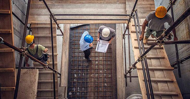 construction-high-angle-hard-hats-building-working