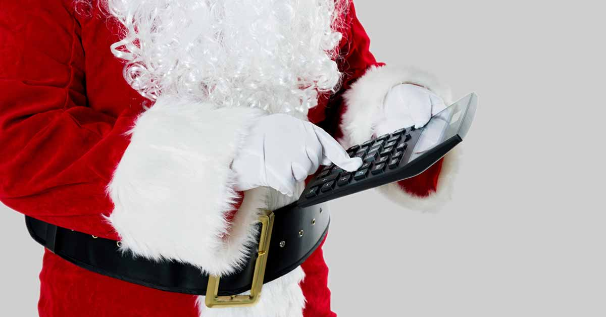 hands-of-santa-claus-and-he-is-using-a-calculator
